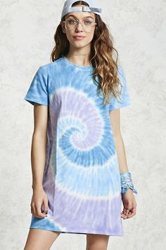 Style Deals - A knit T-shirt dress featuring an allover tie-dye print, short sleeves, and a round neckline.