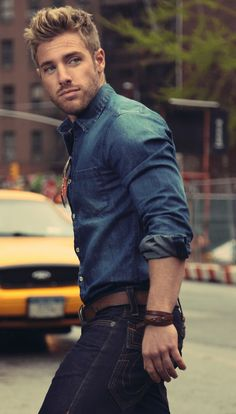 Denim button-up shirt and dark denim jeans with brown belt and brown leather…