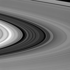 The Great Divide (NASA Cassini Saturn Mission Image) The 2,980-mile-wide (4,800-kilometer-wide) division in Saturn's rings is thought to be caused by the moon Mimas. Particles within the division orbit Saturn almost exactly twice for every time that Mimas orbits, leading to a build-up of gravitational nudges from the moon. These repeated gravitational interactions sculpt the outer edge of the B ring and keep its particles from drifting into the Cassini Division.