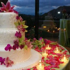Fresh flowers on a tropical wedding cake  For your luxury holiday, tropical wedding or honeymoon visit www.rumours-rarotonga.com/