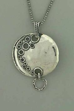 "Bubbly Necklace Hand made, oxidized sterling silver necklace with large bubbly pendent and a little drop down circle. One item only. Chain: 19"" long and 21"" long with pendent. Price: $112.00"