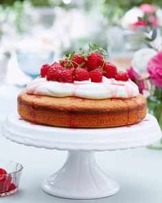 Orange blossom, lemon thyme and almond cake with rosé red berries A stunning, summery bake that sees a zesty orange and almond sponge slathered in a honey and orange blossom cream, then drizzled in rosé red berry syrup. Summer Cake Recipes, Summer Cakes, Fruit Recipes, Cupcake Recipes, Lemon Sponge Cake, Afternoon Tea Recipes, Easter Dinner Recipes, Berry Cake, Almond Cakes