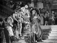 "Lon Cheney descends the grand staircase of the Paris operahouse, dressed as Red Death, during a masquerade scene from the 1925 film, ""Phantom of the Opera."" Get premium, high resolution news photos at Getty Images Silent Horror, Silent Film, Old Hollywood, Hollywood Stars, Classic Hollywood, Image Paris, Lon Chaney, Mileena, Dramatic Arts"