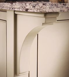 """Open shelves option - Molding and Accent Details - Cove Corbel - KraftMaid *might just make my own or buy from a """"reproduction craftsman"""" to make antique styled corbels to hold shelves"""