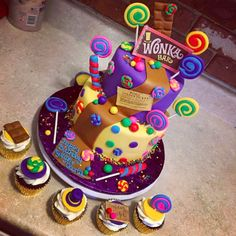 A scrumdiddlyumptious Willy Wonka and the Chocolate Factory cake.