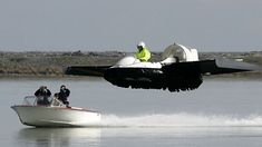 The 'Hoverwing' home-made hovercraft-type vehicle on a test flight with a rescue vehicle i...