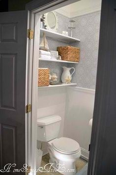 ✔ GUEST BATH: wall-to-wall shelving creates more space horizontally and visually fills up corner (first thing seen after opening door). Also like wainscoting and wallpaper (alternative: painted pattern). Would use this arrangement if I chose to have a pedestal sink.
