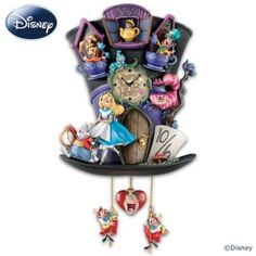 """Fully sculpted cuckoo clock features beloved characters from """"Alice in Wonderland"""". Lights up, glow-in-the-dark details! Mouse in a Teapot cuckoo."""