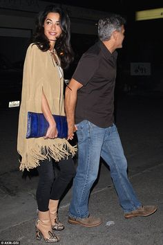 She's a stunner: Amal looked exquisite in a brown fringed cape and Gucci ankle boots