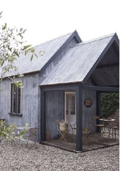 Love this little building with corrugated sheet metal exterior! It would make an adorable guest house. #metalgardensheds