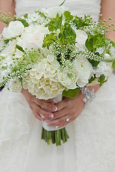 hydrangea, lismachia, geranium foliage, garden roses, ranunculus, stock, queen anne's lace, and bupleurum