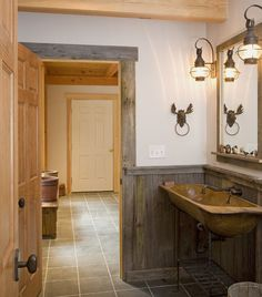 #wood #sink basin, iron plumbing and lighting #fixtures, and barn timber paneling. Moose head towel ring