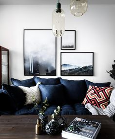 I love the combination of photography on the wall- negative space on white walls. design by Moodhouse in Stockholm / via planete deco