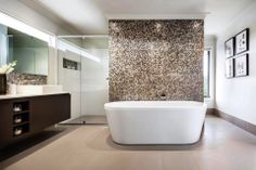 Choose a statement bath. A freestanding bath continues to be the ultimate nod to decadence. It draws the eye immediately and signals to anyone entering the room that this is a place of indulgence. Freestanding baths work best in a large bathroom so there is plenty of room around the bath for access and cleaning. Rawson Homes, Bathroom Feature Wall, Interior Design Work, Bath Tiles, Large Bathrooms, Color Tile, Home Goods, Freestanding Bath, Luxury