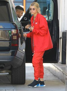 Red hot: Sofia Richie, 18, dazzled in a bright red tracksuit in Malibu on Monday