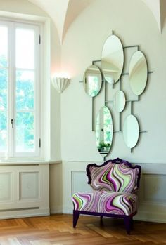 Love the chair & it's fabric   Art Deco Miami Style contemporary hall