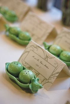 The bride created the escort cards	using a kit from Michaels, and presented them with Two Peas in a Pod salt and pepper shakers by Kate Aspen, which were given out as favors.