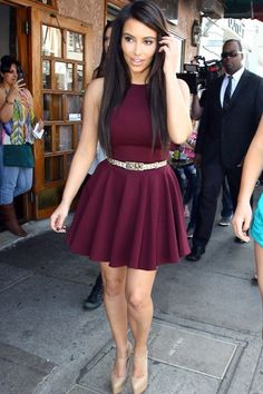burgundy fit and flare dress. nude platform pumps, straight sleek hair