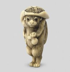 Tanuki (Magical Fox-Like Dog), Ivory Netsuke, Kyoto School. Shown wearing a lotus-leaf hat and carrying the accoutrements of a monk (a double gourd and drum). Late c, Japan. Kyoto, Chinoiserie, Lotus, Japanese Characters, Japan Art, Wood Carving, Stone Carving, Lion Sculpture, Ivory