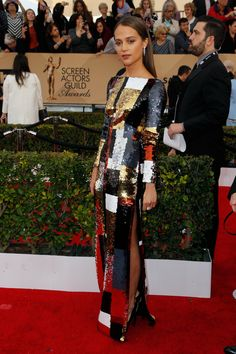 Side view of Alicia Vikander's metallic sequined Louis Vuitton dress and Vuitton jewels at the 2016 Screen Actors' Guild Awards.