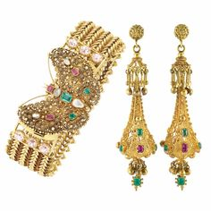 Bracelet and earrings set in gold set with opals, rubies, emeralds and pink sapphires, circa 1830.