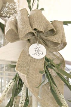 Lanterns, Burlap and Bows ~ a neutral centerpiece that can take you from summer right into fall.