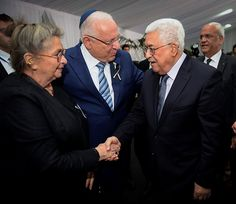 Israeli President Reuven Rivlin and his wife Nechama greet Palestinian Authority President Mahmoud Abbas during the funeral for President Shimo Peres at Mount Herzl Cemetery in Jerusalem, photographed by Mark Neyman (September 30, 2016).