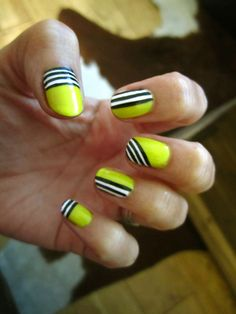 neon yellow w/ black and white stripes nails