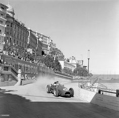 itsbrucemclaren: The Monaco Grand Prix; Monte Carlo, May 18, 1958. Luigi Musso, the great Italian hope of the Ferrari team, trying very hard at the old Tabac corner on the harbor front in his new lightweight 246/F1 Dino which replaced the older V8 cars derived from the Lancia D50 of 1955.