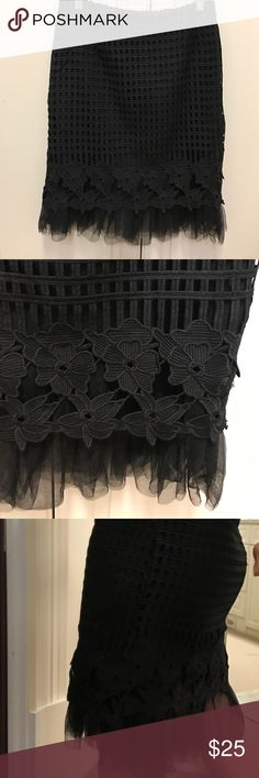 Black skirt Fitted black skirt has two layers one is a window pain look and then the lining which has some netting around the bottom decorative flowers also embroidered  type never worn. Purchased as a sample for $30. Good condition holly Bracken Skirts Pencil