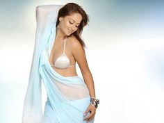 Bollywood actress Kaveri Jha in light blue colour plain saree paired with bikini style blouse.