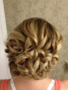 Beautiful updo for long, thick hair during wedding or dance season