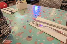 Pink and aqua formica table top at Big Daddy's in New York City / funkyjunkinteriors.net