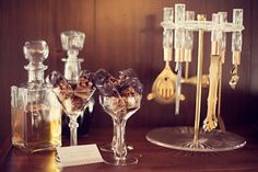 Pin for Later: Have a Mad, Mad Men Wedding Classy Booze A well-stocked liqueur bar is glammed up with vintage accoutrements. Photo by Julie Harmsen Photography via The Wedding Chicks