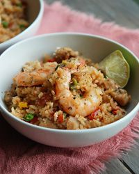 Andrew Zimmern stews chicken and shrimp with rice, toasted coconut and fiery chiles for a crowd-pleasing one-pot meal.