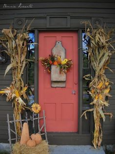 Autumn Decorated Entryway - I like the cornstalks and will probably use them this year if I can get some on the cheap