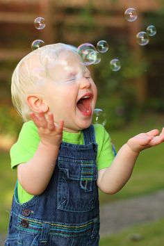 Blowing bubbles for your grandson and watching him giggle with joy.