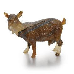 A FABERGÉ CARVED STRIATED AGATE FIGURE OF A SHE-GOAT, ST. PETERSBURG, CIRCA 1900 depicted standing, her head turned to the left and tail uplifted; with diamond eyes
