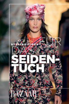 Das Seidentuch ist ein absoluter Klassiker im Kleiderschrank und es kann auch sehr cool aussehen! Die sechs schönsten Styling-Varianten auf harpersbazaar.de.. #trends #fashion #seide #tuch #accessoire #sommer #trend #trending #bellahadid #blumen #print