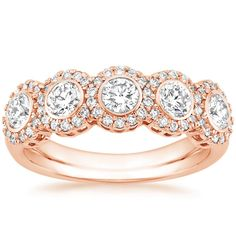 14K Rose Gold Quintessa Diamond Ring (1 ct. tw.) from Brilliant Earth. Would look beautiful with peach champagne sapphires instead of the larger diamonds!