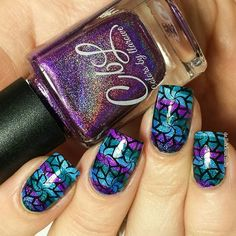 Colors by llarowe watermarble nails with Jewel Of Denial, Ice Ice Baby, Plum Perfect, then stamped using Pueen Cosmetics plate 79 and Creative Shop Stamper from What's Up Nails. Nail art by @delishiousnails