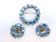 Weiss brooch and clip on earring set in shades by MeyankeeGliterz
