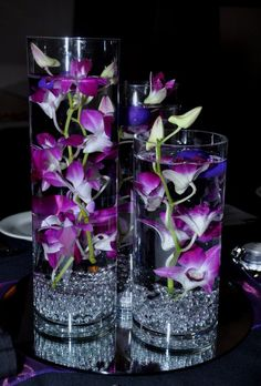 This would be an amazingly beautiful centrepiece for a wedding if it had cala lilies instead of orchids