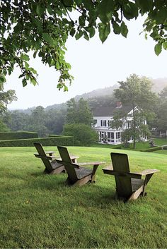 Adirondack chairs near the edge of the woods overlook the hornbeam room at Middlefield, in Upstate New York.
