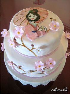 Mulan cake.  Love the Cherry Blossoms, but gotta work on the topper.