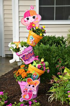 Desi and her two daughters made this Lala-lovely topsy turvy planter! It looks sew cute in their front yard! How cute would this be in a play garden!!!!