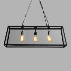 World Market - Rectangular 4-Sided Glass Pendant Lamp - $269.99  Crafted of clear glass panes set in a black iron frame, our exclusive pendant lamp is a dramatic, three-dimensional statement piece ideal for the dining room or any large space.