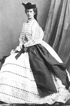 Elisabeth by Oscar Kramer in 1863. Sissi's dress has French sleeves as well as the enormous bow or sash. It might be a Worth due to it`s complexity.