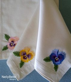 Pick a posie of pansies. Embroidered pansies on ivory cotton napkins. NellyBelle designs