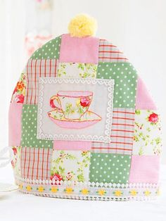 patchwork tea cosy - I could do something like that with my Grandmother's embroidered dish cloths